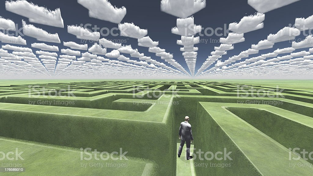 Figure inside of maze with arrow clouds above royalty-free stock photo