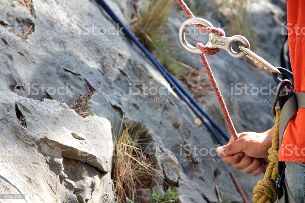 Figure of eight: Rock climber holding the rope stock photo