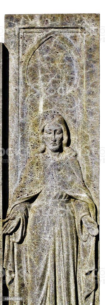 Figure of Jesus biblical clothing on gravestone royalty-free stock photo