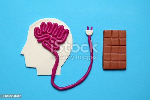 istock Figure of man and bar of sweet chocolate. Nutrition brain energy for mind 1134881032