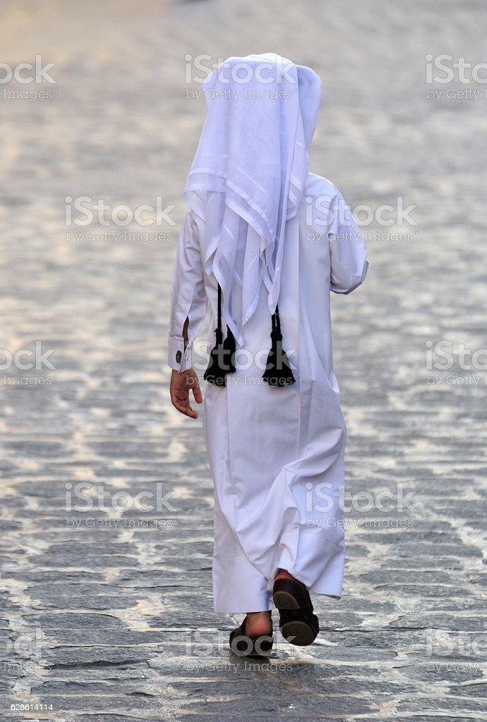 Figure of unidentifiable Arabic boy stock photo