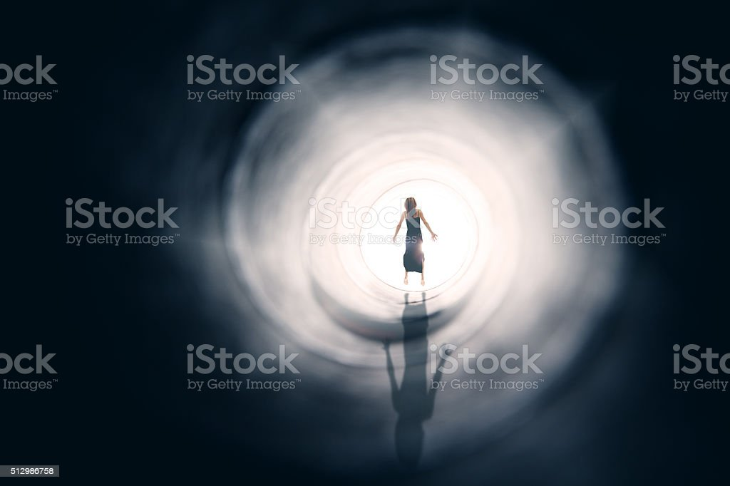 Figure Of Woman Floating In Light stock photo