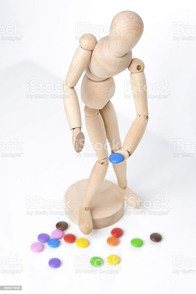 Figure picking up candy royalty-free stock photo