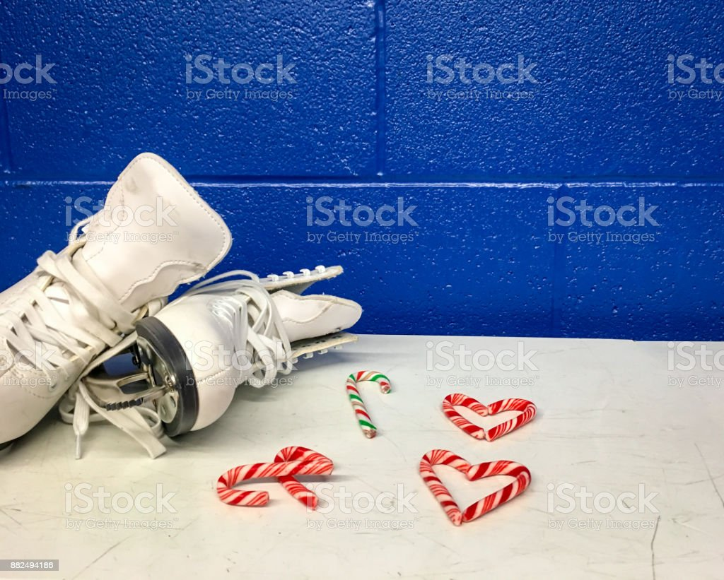 Figure skate with candy canes hearts in locker room stock photo