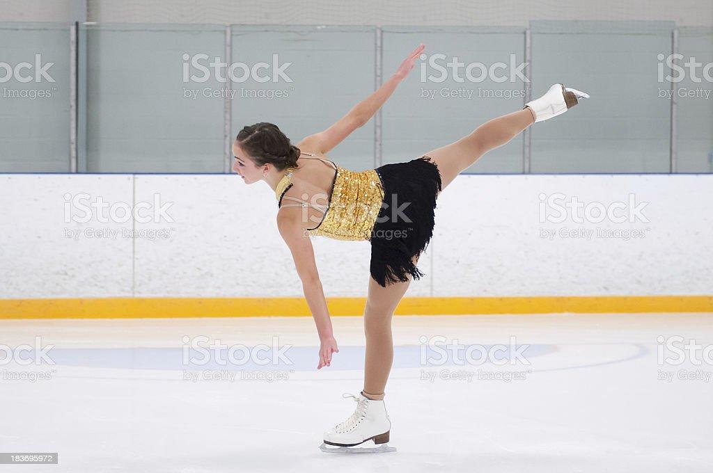 Figure skater glides on one leg stock photo