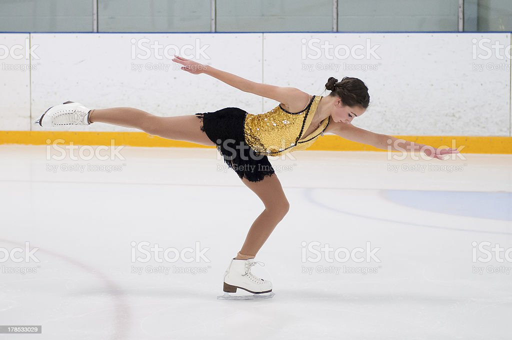 Figure skater gliding stock photo
