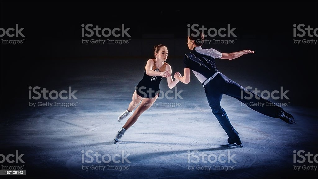 Figure skating pair performing stock photo