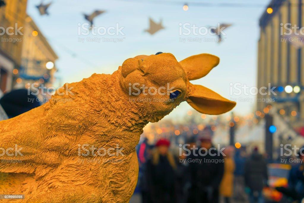Figured yellow rabbit on the street stock photo