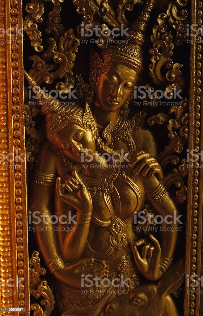figures from temple in Luang Prabang stock photo