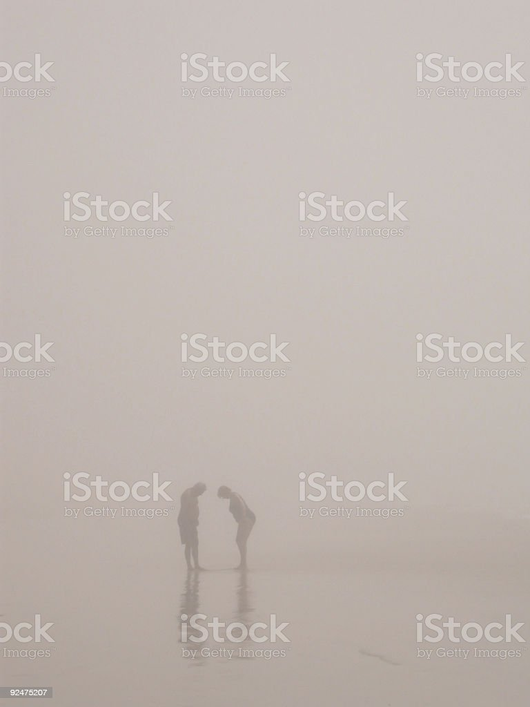 Figures in Sea Mist 2 royalty-free stock photo