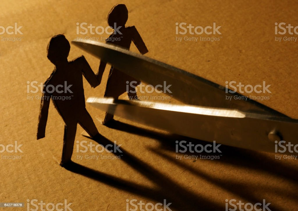 Figures of couple from paper and scissors. stock photo