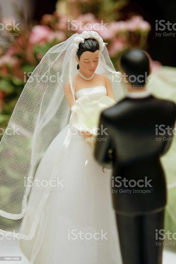 Figures of groom and bride on a wedding pie stock photo