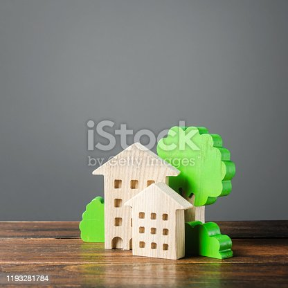 istock Figures of houses and trees. Affordable comfortable housing. Purchase of apartments and real estate, rent and sale. Housing, new home. Mortgage. Cozy ecological modern neighborhood. Urban science 1193281784