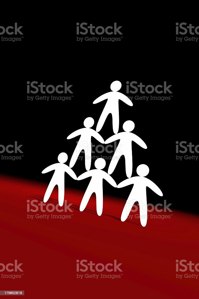 Figures of man in pyramid form royalty-free stock photo