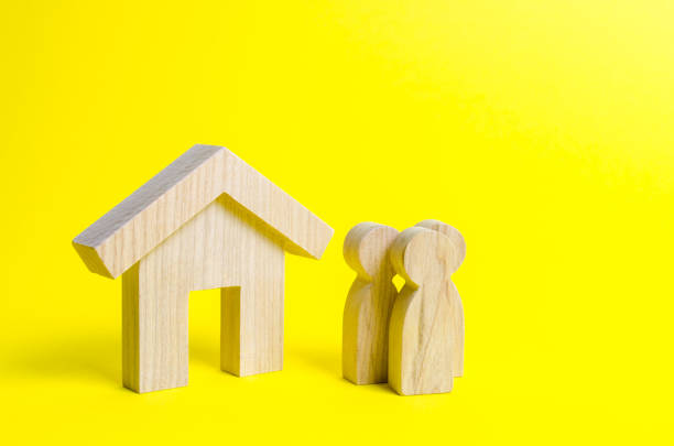 Figures of the family and house on a yellow background. real estate, your own home. Buying or selling. Affordable housing on credit or mortgage. Renovation and construction. Subsidies, citizenship. stock photo