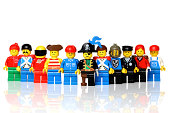 London, United Kingdom - July 18, 2011: A group of lego mini figures  on white background. The lego figure is a small plastic toy available through the Danish toy manufacturer the Lego Group. They were first produced in 1978