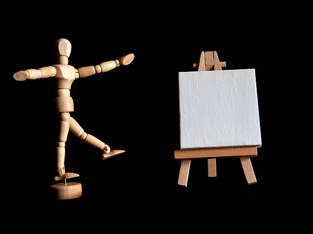 Figurine and Blank Canvas on Easel stock photo
