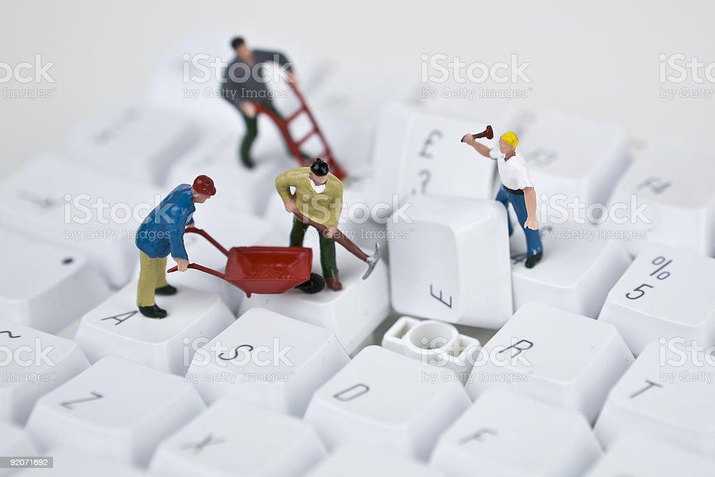A figurine computer maintenance team stock photo