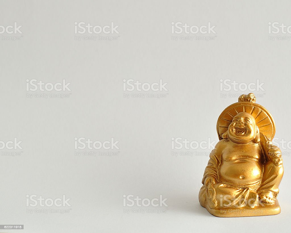 Figurine of a laughing and cheerful golden Buddha stock photo