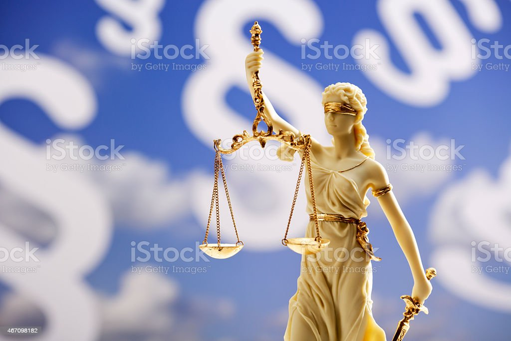 Figurine of justice holding scales stock photo