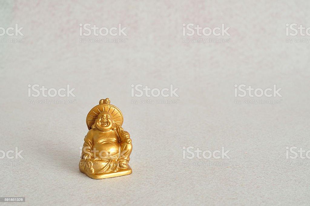 Figurine of laughing and cheerful golden Buddha stock photo