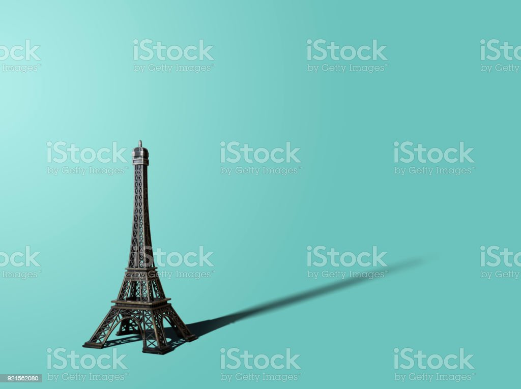 Figurine of the Eiffel Tower on a pastel background. stock photo