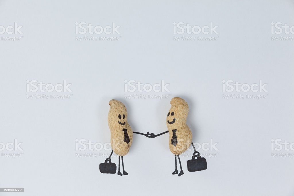 Figurine of two businessmen shaking hands stock photo