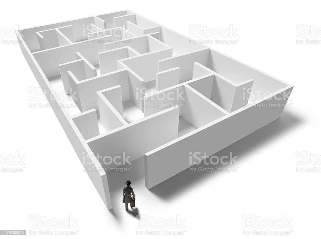 Figurine standing at opening of maze royalty-free stock photo