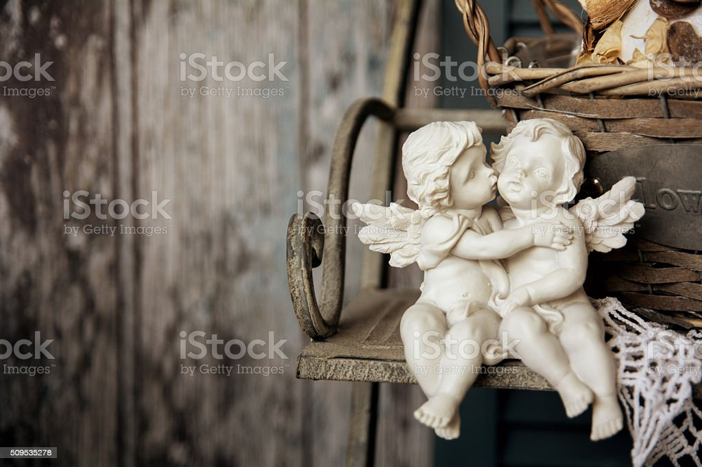 Figurines angels sitting on a bench stock photo