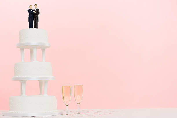 Figurines wedding cake and champagne stock photo