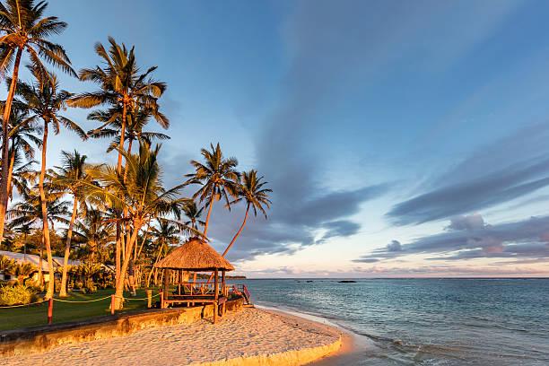 fiji island beach hut sunset coral coast viti levu - fiji stock photos and pictures