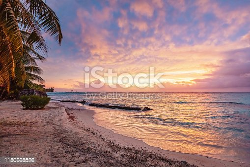 Colorful vibrant sunset over the pacific ocean at scenic natural beach Viti Levu, Fiji. Korotogo Coast, South Coast, Western Division, Fiji, Oceania