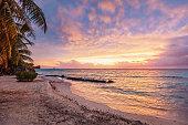Colorful vibrant sunset over the pacific ocean at scenic natural beach Viti Levu, Fiji. Korotogo Coast, South Coast, Western Division, Fiji, Oceania