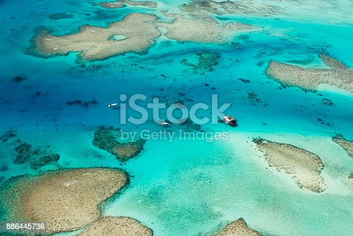 Corals and paradise islands at the Fiji Islands east of Australia in the middle of the pacific Ocean. Seen during a hot day in the summer.
