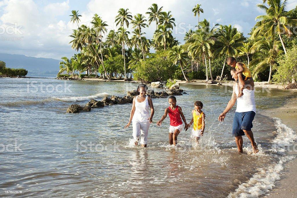 Fijian Family Playing on The Beach stock photo