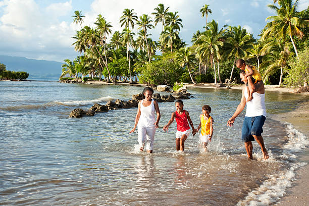 fijian family playing on the beach - fiji stock photos and pictures
