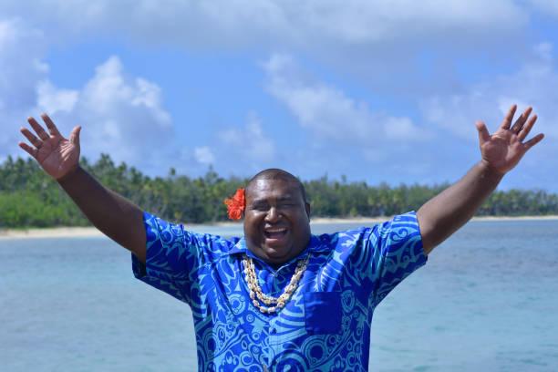 fijian man greets hello in fiji - bula - fiji stock photos and pictures