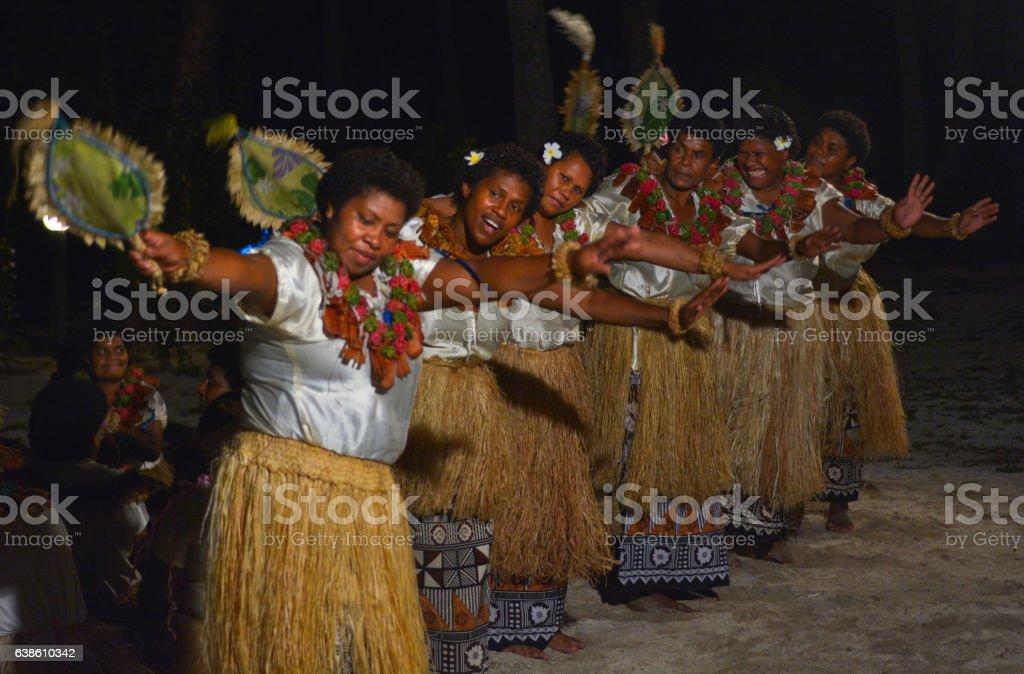 Fijian women dancing traditional female dance Meke the fan dan stock photo
