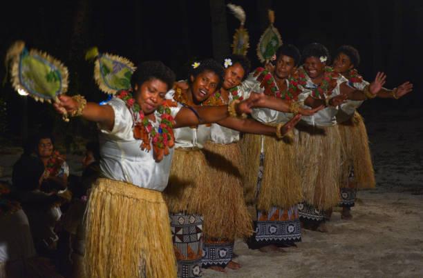 fijian women dancing traditional female dance meke the fan dan - fiji stock photos and pictures