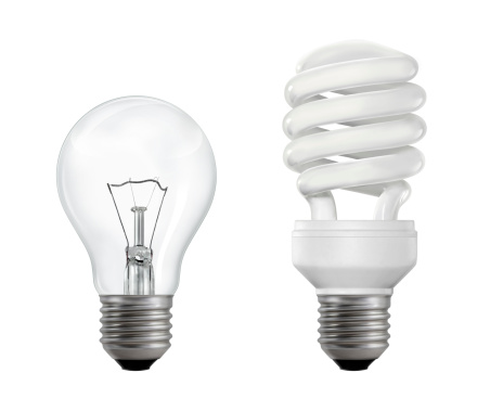 Classic (filament) and compact fluorescent lightbulbs isolated on white background.