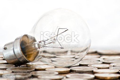 istock filament bulb lying on euro coins 152123839