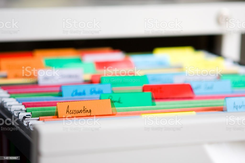 A file cabinet organized with colors stock photo