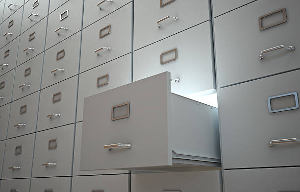 File cabinet with an open drawer stock photo