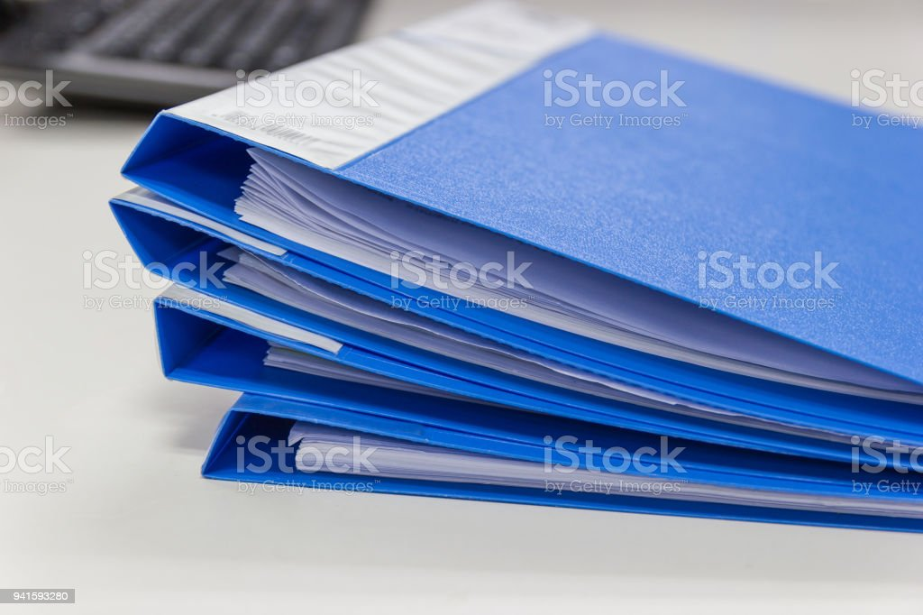 file folder and Stack of business report paper file  on desk in office, business concept. stock photo