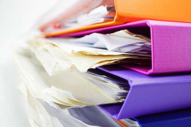 File Folder Binder stack of multi color on table in office. stock photo