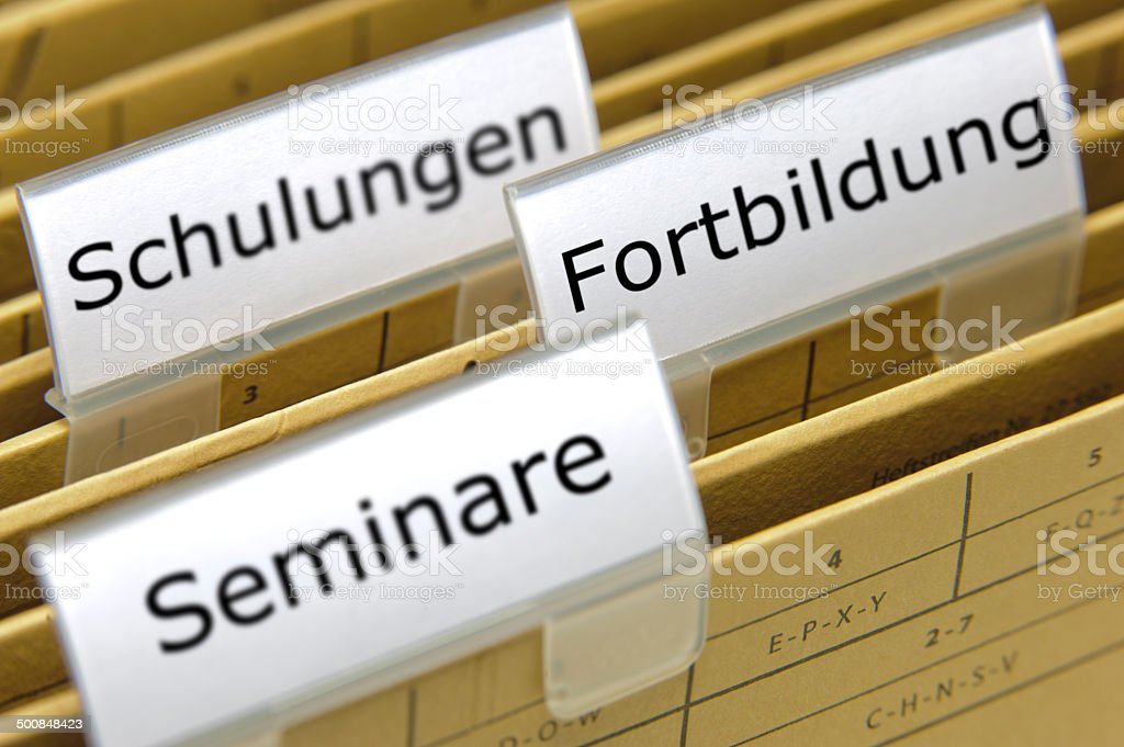 file folder marked with different educations in germany stock photo