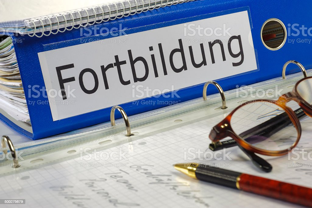 file folder marked with Fortbildung stock photo