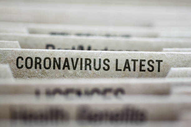 File folder of coronavirus latest updates stock photo
