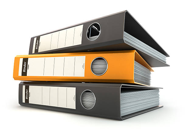 File folders or ring binders full with office documents. stock photo