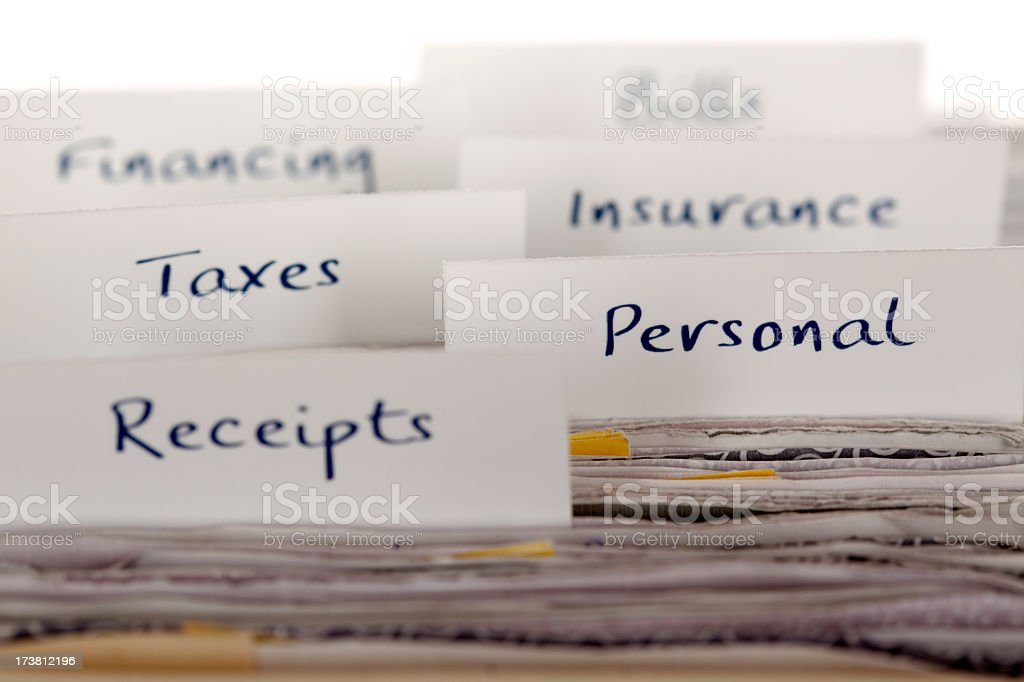 File labels showing financial and personal filing system stock photo